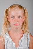 Portrait of blonde girl with a freckled face and two tails — Stock Photo