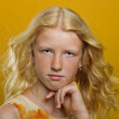 Beautiful blonde girl on a yellow background — Stock Photo #26973685
