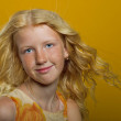 Beautiful blonde girl on a yellow background — Stock Photo