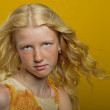 Beautiful blonde girl on a yellow background — Stock Photo #26973707