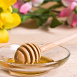 Sweet honey in jar with drizzler — Stock Photo #34793635