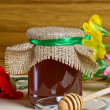 Sweet honey in jar with drizzler — Stock Photo