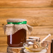 Sweet honey in jar with drizzler — Stock Photo #34793647