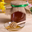 Sweet honey in jar with drizzler — Stock Photo #34793671
