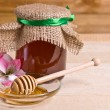 Sweet honey in jar with drizzler — Stock Photo #34793687