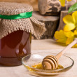 Stock Photo: Sweet honey in jar with drizzler