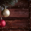 Christmas card with a gold and red toys — Stock Photo #34945579