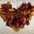 Vintage heart from dried rose petals — Stock Photo #35000811