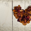 Vintage heart from dried rose petals — Stock Photo #35000865