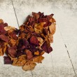 Vintage heart from dried rose petals — Stock Photo