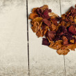 Vintage heart from dried rose petals — Stock Photo #35000895