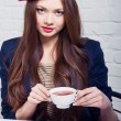 Beautiful girl Frenchwoman drinking tea — Stock Photo #40508021