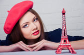 Beautiful girl in a red beret — Stock Photo