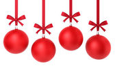 Four hanging christmas balls with nice bow — Stock Photo