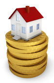 House on stack of golden coins — Stock Photo
