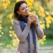 Cute girl with autumn background. — Stock Photo