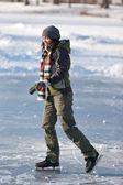 Girl with skates. — Stock Photo