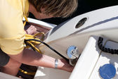Man Connecting Power Cord To The Boat — Stockfoto