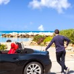Man With Sport Car On The Beach — Stock Photo