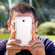 Stock Photo: MTaking Pictures With Smartphone