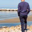 Stock Photo: MOn Beach Watching Over Horizon