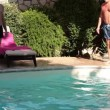 Two Funny CaucasiMen Jumping In Pool — Stock Video #27506995