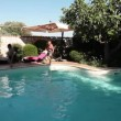 Two Men Jumping In Pool — Stock Video #27507941