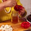 Woman Preparing Pickled Peppers Filled With Grapes — Stock Video
