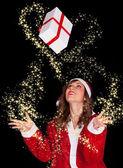 Happy Santa Claus Woman Picking Up Gift — Stok fotoğraf