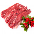 Stock Photo: Raw Beefsteaks And Chili Peppers