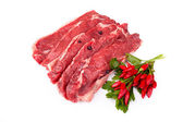 Raw Beefsteaks And Chili Peppers — Stock Photo