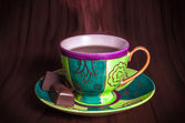 Colourful cup of hot coffee with chocolates Colourful cup of hot tea with chocolates — Stock Photo