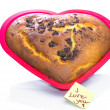 Freshly baked heart-shaped Valentines cake — Stock Photo