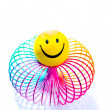 Stock Photo: Smiley on rainbow Slinky toy
