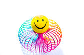 Smiley on a rainbow Slinky toy — Stock Photo