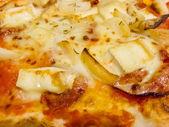 Melted golden cheese on Italian pasta — Stock Photo