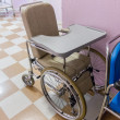 Stock Photo: Empty wheelchair in hospital