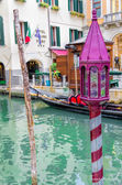 Gondola and gondola lantern in Venice — Stock Photo