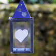 Foto Stock: Hanging lantern with heart motifs