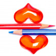 Red and blue pencils with romantic hearts — Stock Photo #29334403