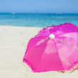 Pretty vibrant pink beach umbrella — Stock Photo