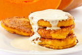 Pumpkin pancakes with sour cream — Stock Photo