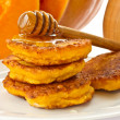 Pumpkin pancakes with honey — Stock Photo #12781216