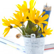 Autumn flowers with book and pencils — Stock Photo