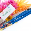 Autumn flowers with book and pencils — Lizenzfreies Foto