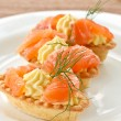 Tartlets with salted salmon — Stock Photo