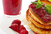 Pancakes with raspberries — Stock Photo