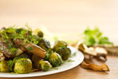 Roasted brussels sprouts and mushrooms — Stock Photo