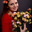 Portrait of a girl with a bouquet of flowers — Stock Photo #16891763
