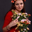 Portrait of a girl with a bouquet of flowers — Stock Photo #16891765